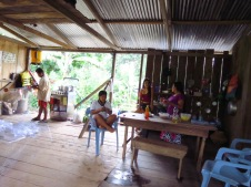The wonderful local family, from whom we are renting some land during the construction. The father and his two 20-something sons help us construct the raft while the women cook lunch for us. The family belong to the Shuar Trinbe who have lived in the Amazonia jungle for milennia. The father is preparing some fishingnets in this photo.