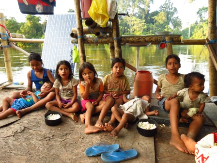 We invited the local river-kids for popcorn on our raft