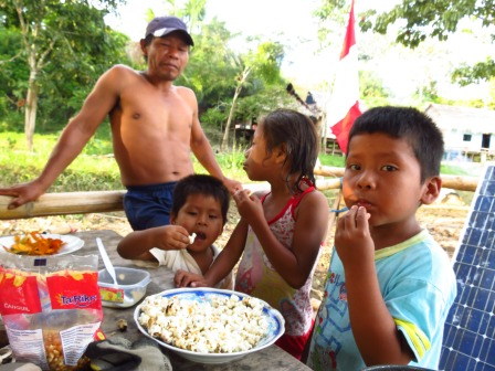 Serving popcorn for the kids, normally wins the friendship of the locals