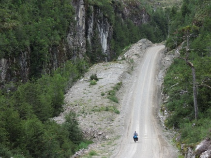 Peycho fighting his way up a gravel climb on the Carreterra Austral