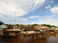The stilted houses on the river-front of Pebas. Notice the telecommunication pylon in the background; these could be seen 10-15 miles (25km) away and was always a clear sign that we were approaching a town
