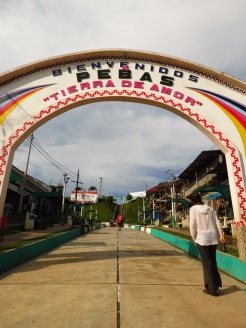 """Welcome to Pebas. The Land of Love"" the arch reads."