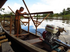 Constructing a roof for our boat, before heading upstream on a multi-day expedition. Carrying food and equipment with us, we need the roof to protect ourselves as the rain will hit us at some point