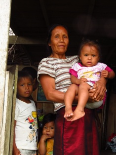 The grandmother rushed inside the building and fetched all her grandkids for a photograph, one by one.