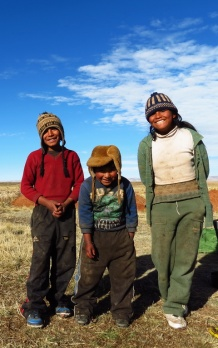 Don't have much, but they have a smile; these poor, rural Bolivian high-plain farmer kids.