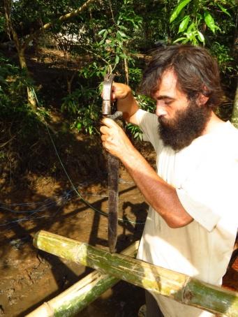 Peycho, constructing with a machete