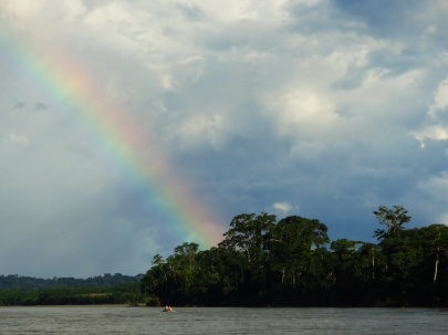 Local indigenous people are transiting the river, heading for the rainbow?