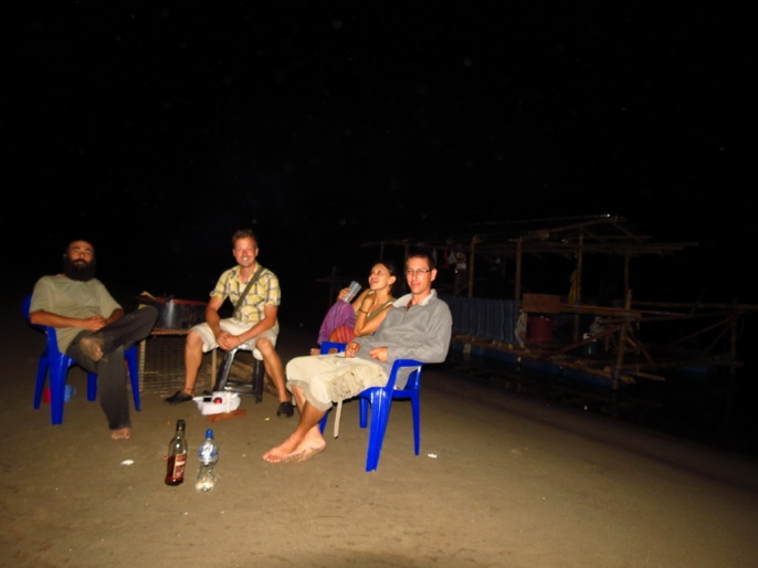 Our first night: We barbequed a chicked and drunk some rum on a lonely, quiet river-beach.