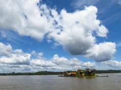 Construction equipment for oil-extraction projects, transiting on the river