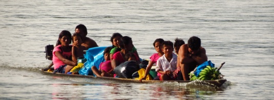 "I count 11 people on that ""casco"" plus various food and bagage. I was always so scared that they would capsize and loose all their things."
