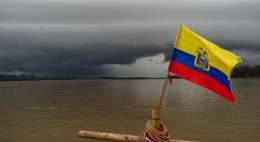 A rainstorm is approaching as the black clouds are gathering and our flag are wiped into action